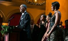 Barack Obama, with first lady Michelle, and daughters, Malia, left, and Sasha, join performers on stage for the Christmas in Washington TV show in 2014.