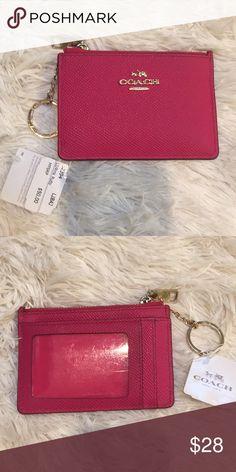 e401a1965 NWT Coach coin purse PINK NWT PINK small coin purse. Back plastic has a few
