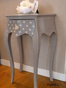 Maybe we could do this to one of the end tables that I have? (Color depending on what scheme we pick for the living room.) The dots match a chair that I have!