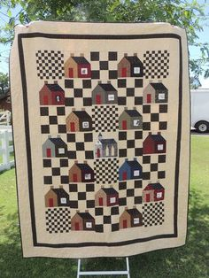 Lovely house quilt with checkerboard and nine patches!