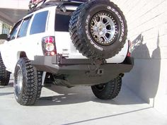 Rear bumper with tire carrier for Grand Cherokee WJ