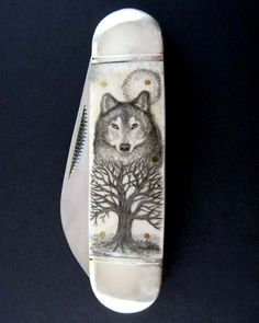Original scrimshaw wolf spirit totem pocket knife by moosupvalleydesigns,