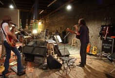 Rusted Root, consisting of Jenn Wertz, left, Mike Glabicki, right, and Jim Donovan, Patrick Norman, Liz Berlin, and John Buynak, rehearse in their downtown studio rehearsal on April 1, 2002.  (Philip G. Pavely     Trib Total Media)