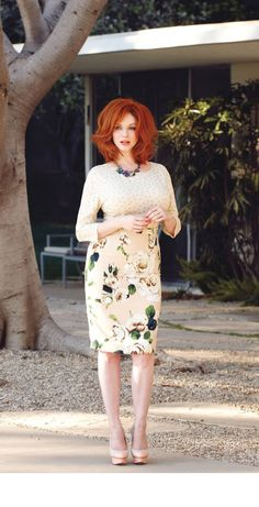 "CHRISTINA HENDRICKS = Mrytle Wilson  ""..The thickish figure of a woman blocked out the light from the office door."" (63) ""Her face, above a spotted dress of dark blue crepe-de-chine, contained no facet or gleam of beauty, but there was an immediately perceptible vitality about her as if the nerves of her body were continually smoldering."" (63)"