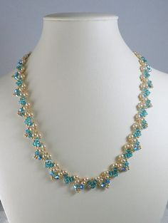 Woven necklace with pearls and Swarovski crystals Sea inspired hand woven necklace. Ive used blue/green Swarovski crystals securely woven with creamy white glass pearls, Swarovski crystals and tiny golden seed beads. Super sparkle and shine. Seed Bead Jewelry, Bead Jewellery, Beaded Jewelry, Seed Beads, Beaded Necklace Patterns, Jewelry Patterns, Diy Necklace, Fashion Necklace, Swarovski Crystal Necklace