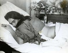 In this undated photo, released by the Frida Kahlo Museum, the artist Frida Kahlo lies on a bed; she suffered from back injuries caused by a streetcar accident when she was a youth.