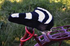 Crochet bike seat cover - even tho this takes some customizing, size-wise, it is still a quick-and-easy crochet project. I don't have a bike but I sure would have fun making these for others....this crocheter is a genius for figuring this out for us...