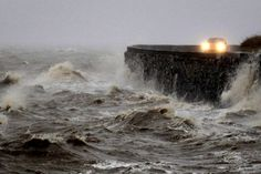 untrustyou:  Strong winds and high tides battered a coastal road close to Newtownards, Northern Ireland, Sunday Jan 5, 2014. (Peter Morrison/Associated Press)