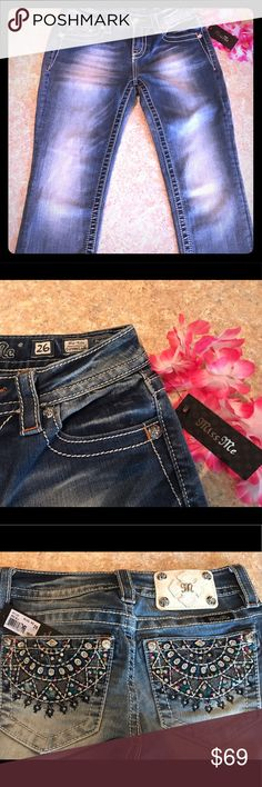 🎉NWT🌸Miss Me 🌺Size 26 Mid-Rise Cuffed Capri ⭐️ 🎉 NWT 💥 GORGEOUS 😍🌸 Miss Me size 26 Mid - Rise Cuffed Capri ! These have colorful graphic design back pockets with Rhinestones! Smoke free Home ! NWT Total length 30 inches, inseam 20 inches and a tiny bit of stretch to these but not a lot . Thought I could make these work but I'm a true 3/4 27 in miss me ! These fit a 1/2 best ! No trades at this time .😉🌸 Miss Me Pants Capris