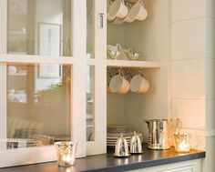 Kitchen with glass sliding cabinet doors