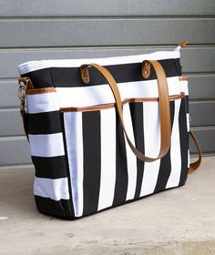 """""""The Brit"""" by White Elm is a soft and lightweight diaper bag that has plenty of storage and space. Features: - Soft cotton denim exterior - 8 Total pockets for maximum storage Exterior / 4 Interior Recycling For Kids, Diaper Bag Essentials, Boy Diaper Bags, Striped Tote Bags, Recycle Jeans, Baby Necessities, My Baby Girl, Baby Accessories, Baby Gear"""