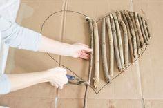 How to make a heart shaped wall art out of driftwood or tree branches and twigs. Includes tips on branch selection and shows how to tie branches together.