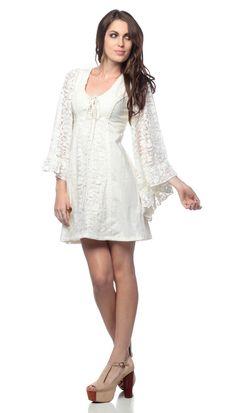 Lace Gunne Sax Dress 70s Vintage Hippie White cotton Bohemian mini dress with crochet angel sleeves, empire waist, bell skirt, a crochet lace front panel overlay that laces up to a drawstring, and a zipper back--Christian gets Ana dressed for the day.