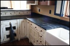 Dark soapstone very grainy, but I like it if it's right. BTW how about these distressed cabinets & white farm sink? Soapstone Counters, Soapstone Kitchen, Kitchen Countertops, Kitchen Cabinets, Granite, New Kitchen, Kitchen Decor, Kitchen Ideas, Kitchen Inspiration