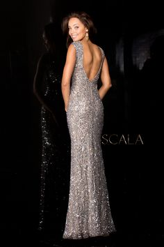 dccfc00b0b Be absolutely ravishing in Scala Couture This long gown offers a boat  neckline of sheer fabric with sheer detail panel the center.