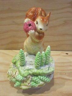 "Vintage Schmid Music Box ""The Tale of Squirrel Nutkin"" Figurine by Beatrix Potter * Music Box Plays ""Raindrops Keep Falling On My Head"" by RainbowConnection15 on Etsy https://www.etsy.com/listing/264628381/vintage-schmid-music-box-the-tale-of"