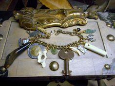The Taxidermist Shop: Venice, Italy Edition. Rabbit bone coyote leg bone Italy Coin 500 L  religious relics Ancient sea glass sailboat Teeth