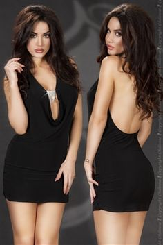 Black clubwear mini dress with jewellery detail at front by Chilirose dresses.This dress is low at back and front of dress and clasped with a pretty silver ornament piece. Size: Small/Medium. Buy now on-line with worldwide shipping from Ireland