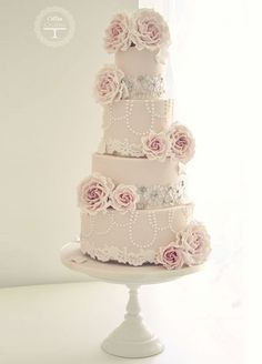 This pretty pale pink confection is filled with sweet touches like lush pink sugar flowers and lace trim.