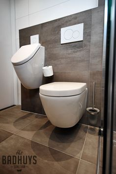 Wall hung toilet and urinal and I'd also place a bidet and bidet shower spray next to toilet on the wall  with hot and cold water to wash yourself instead of paper much fresher and cleaner we do it a lot in Sweden