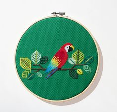 I am in love with birds, and this is the first in a long line of aviary cross stitch patterns Ive got in the works! The Macaw Parrot is a symbol of tropical delight to me. These majestic, colourful birds stole my heart and imagination, and inspired this colourful one of a kind pattern. Please note that this is a downloadable PDF pattern, and does not come with the supplies required to make this piece. You do however get all of this: - reference cover photo of finished piece -colour chart…