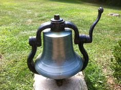 Cast iron bell. I do not know the manufactured date of this bell. Unfortunately I do not know the origin either. It was my grandfathers & now sits proudly in my front yard. The cast base is actually submerged in the concrete to prevent theft. It gets rung quite a bit on the 4th of July without fail.