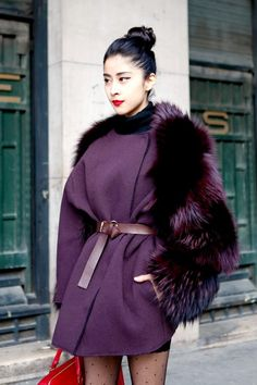 Get Denni's look: Lanvin fur coat (similar burgundy faux fur coats here and here), Saint Laurent leather duffle bag (alternative red leather bag here), spotted tights (on sale) and suede lace-up booti