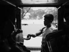 The all around man--protecting passengers from the bad elements collecting the fares of the passengers and looks on for prospective passengers of a Philippine jeepney. Urban Photography, Street Photography, Jeepney, Never Stop Exploring, Gabriel, That Look, Universe, Magazine, Activities