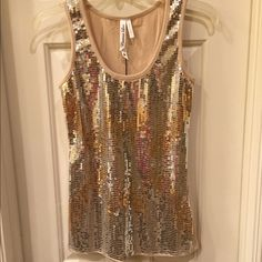 Christina Love NWT sequined tank size M NWT  cotton race back tank has front sequined detail and Size M retail tags attached no flaws Christina Love Tops Tank Tops