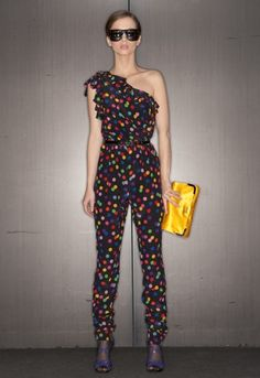 Model in Dolce & Gabbana Polka Dot Jumpsuit, with Gold D Clutch.