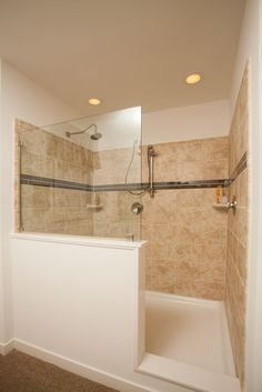 Colony Homes - Max 2 CN338A - Cornerstone Modular Ranch - Walk-in Ceramic Tile Shower - large ceramic tiles, mosaic insert, half wall, double shower heads