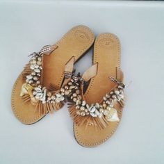 Sandals decorated with pearls and seashells. Elenas Sandals