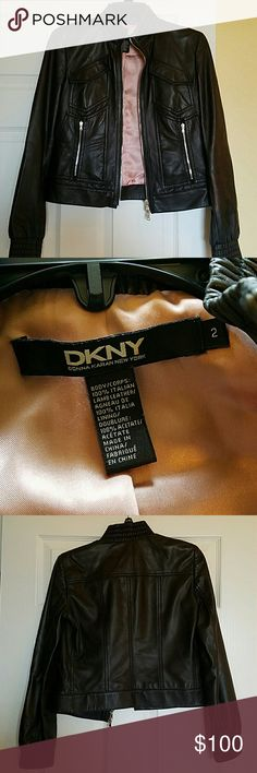 DKNY Moto Leather Jacket Gorgeous DKNY Moto Jacket. 100% Italian Lamb Leather with baby pink lining. Butter soft with edgy silver zipper detailing. Perfect with all black and sexy sky high heels or even to jazz up a pair of jeans and t-shirt. This jacket is an insta-upgrade to any outfit. DKNY Jackets & Coats