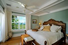 The hand-carved king size bed is placed in the bedroom to enjoy ocean views while lounging in bed. French doors adjoining the bedroom lead you to the 2nd floor porch at the back of the house so you can open the doors and take in the sea breeze.  http://vacationhomesofkeywest.com/ultimate-key-west-beach-house---sunset-key-~-vip.html