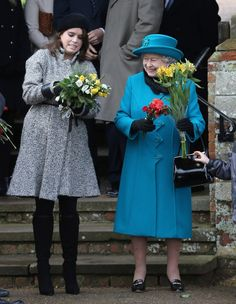 Princess Eugenie and the Queen following the 2012 Christmas service at St. Mary Magdalene Church in Norfolk, England.