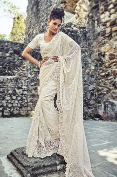 This is an Indian bollywood Pakistani wedding and party wear designer saree blouse. Saree crafted in Net with Border work embroidery. and Silk Unstitched blouse Fabric. Off White Saree, White Sari, Cutwork Saree, Wedding Sari, Wedding Dresses, Net Saree, Casual Saree, Designer Sarees Online, Work Sarees