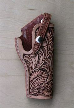 Hand Tooled Leather holster                                                                                                                                                                                 More