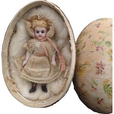 Sweet 19thC all bisque Kammer Reinhardt miniature doll in egg