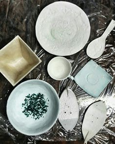 Work in progress. Clay with glaze. Ceramic pottery: cup, plate, soap dish, plant pot, restspoon.