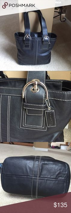 Coach purse Black leather Coach purse with zipper in the middle gently used, the inside is very clean, the leather is very soft and supple no visible sings of wear I used it a few times it comes with a dust bag. It has been very well taken care of. Coach Bags Shoulder Bags