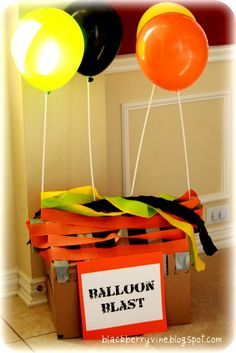 Balloon Blast and other games - My version....I tied 3-4 balloon to a string and then hung from ceiling with a thumb tack...saved me from getting a heilium tank and it was easy to replace when the balloons popped