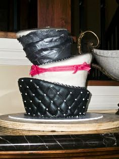 specialty cakes, wedding cakes, topsy turvy cakes, black and pink cakes, 3 tier cakes, http://tiered-expressions.com