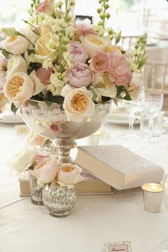 pastel floral bouquet in silver cup and mercury glass tealights <3