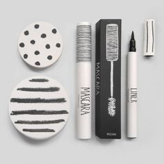 Topshops' make up packaging.  Packaging features matt grey componentry with black patterns, uncoated cartons with grey print, hand drawn illustrations and text. Designer: Sarah Thorne.