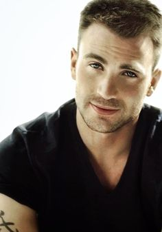 Chris Evans  I get the feeling he's a lot more like his character in What's Your Number than Captain America.  But I don't care.