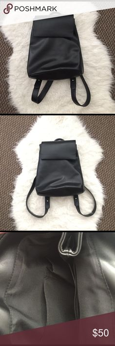 Urban outfitters Faux Leather Black book backpack Worn once super cute!!! From Kimchi Blue at urban outfitters Urban Outfitters Bags Backpacks