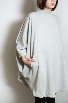 Oversized, panelled Writer Cape with curved hem from Kowtow features front in-panel pockets, rib neckband & sleeve cuffs. Pair with leggings or skinny jeans for a comfortable and statement making look