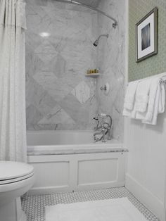 Beautiful, but maybe not in white, maybe in blue or green or even yellow - chic shower/tub combo