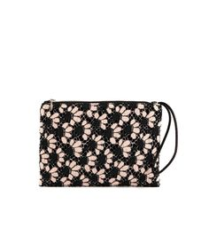 Audrey is a guipure lace clutch with a bucolic floral motif, perfect accessory for a pastel summer touch.
