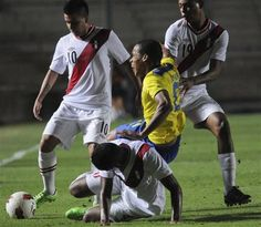 Ecuador's Eli Esterilla, center, fights for the ball unidentified Peru's players during a U-20 South American soccer championship match in San Juan, Argentina, Wednesday, Jan. 16, 2013. (AP Photo/Walter Moreno)